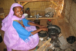 Woman using Darfur Stove