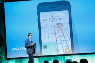 Product Specialist for Waze Mark Campos speaks on stage at a conference in New York. BRIAN ACH/GETTY IMAGES FOR LOCATIONWORLD 2