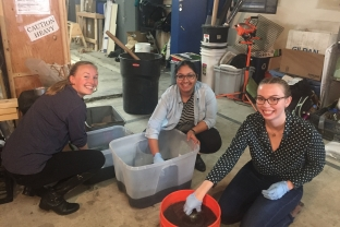 L-R: Ali Mathews, Meera Kota, and Courtney McGuire sample and test wastewater.