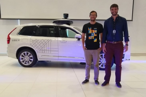 Juan Argote and intern in front of Uber car
